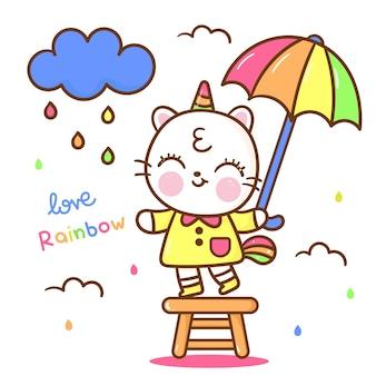 Unicornio gato sosteniendo paraguas día lluvioso