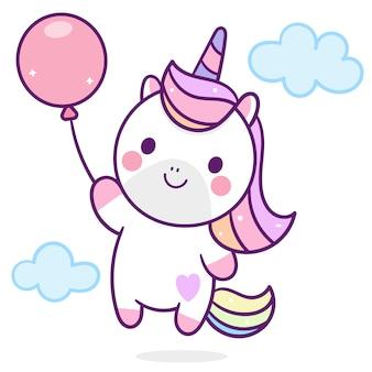 Unicornio lindo que sostiene el globo