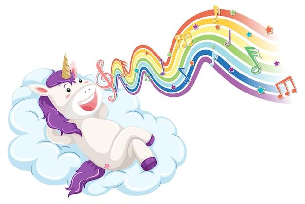 Unicornio tendido en la nube con símbolos de melodía en la onda del arco iris