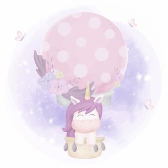 Unicornio volando con globo de aire