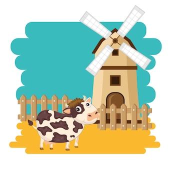 Vaca junto al molino de viento en la escena de la granja