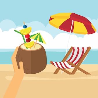 En las vacaciones de verano, coco con bebida fría en la mano.