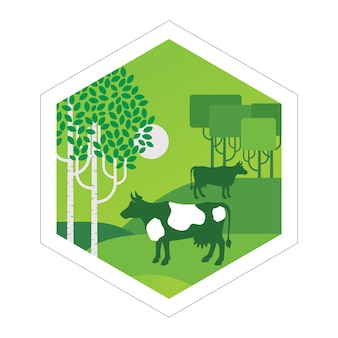 Las vacas pastan en el prado
