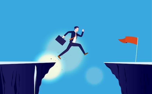 Valiente empresario saltando por el acantilado para alcanzar la meta