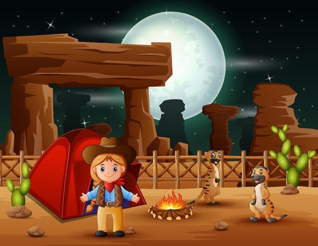 Vaquera de dibujos animados acampando con suricatas en la noche