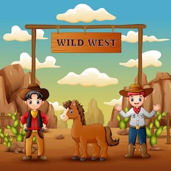 Vaqueros con caballo en la entrada del salvaje oeste