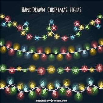 Varias guirnaldas de luces de colores dibujadas a mano