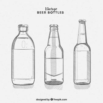 Variedad de botellas de cerveza vintage