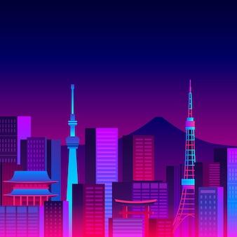 Varios edificios del horizonte de tokio con luces de neón.