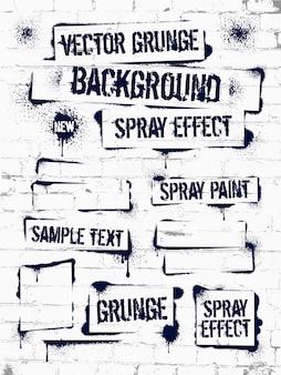 Varios graffiti de pintura en aerosol en la pared de ladrillo