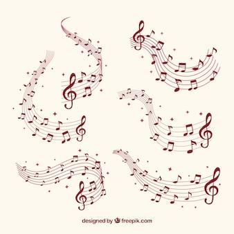 Varios pentagramas con notas musicales
