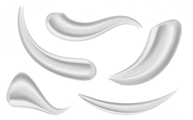Varios trazos belleza cara cosmética crema blanca.