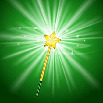 Varita mágica con estrella sobre fondo verde