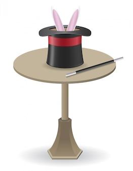 Varita mágica y sombrero cilíndrico sobre la mesa.