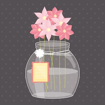 Vaso de tarro de masón con flores y etiqueta colgando