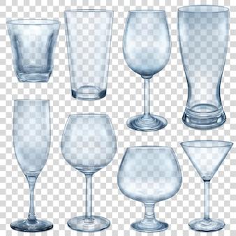 Vasos vacíos transparentes y copas para diferentes bebidas.