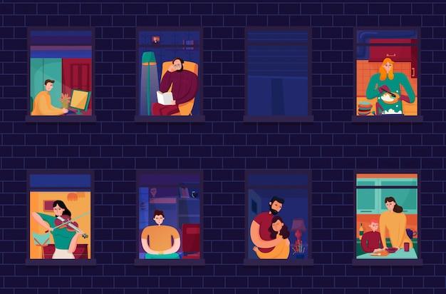 Vecinos durante las ocupaciones nocturnas en ventanas de la casa en la noche de pared de ladrillo