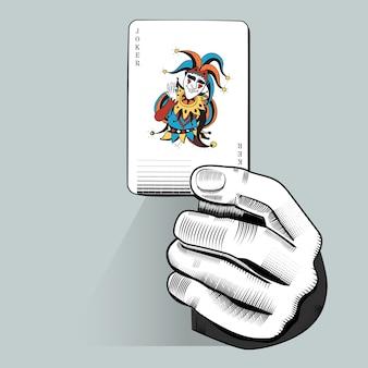 Vector de la mano que sostiene el naipe al azar