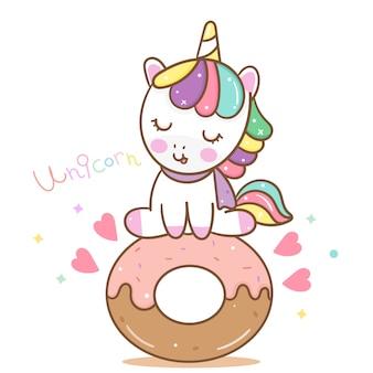 Vector lindo del unicornio con el buñuelo dulce