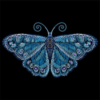 El vector logo mariposa para tatuaje o camiseta o ropa exterior. lindo estilo de impresión de fondo mariposa. este dibujo es para tela negra o lienzo.