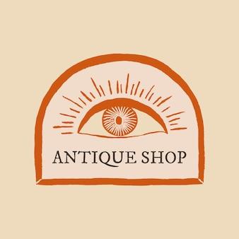 Vector de logotipo de tienda de antigüedades sobre fondo beige con ilustración de ojo