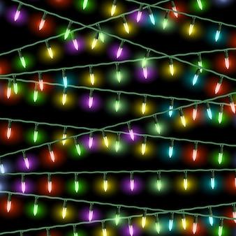 Vector luces de navidad sobre fondo negro