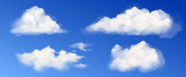 Vector nubes esponjosas blancas en cielo azul