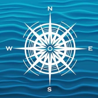 Vector de rosa de los vientos sobre fondo de ondas azules. ilustración vectorial.