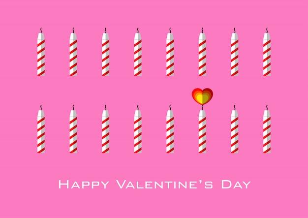 Velas con llamas en forma de corazón para el día de san valentín - fondo rosa