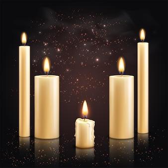 Velas realistas con un conjunto de velas diferentes con llamas y partículas de luz en la ilustración de la superficie oscura