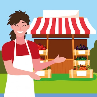 Vendedor con puesto kiosco de tienda de verduras