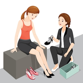 Vendedora servicio mujer cliente en zapatos de mujer compre muy bien