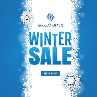 Venta banner de invierno azul con copos de nieve blancos