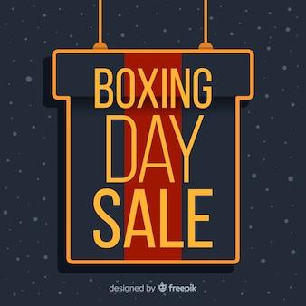 Venta de día de boxeo plano con caja de regalo colgando
