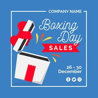Venta de día de boxeo plano con regalo abierto y cinta