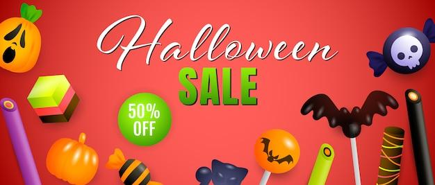 Venta de halloween, cincuenta por ciento de descuento en letras con lindos dulces