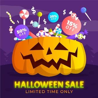Venta de halloween dibujada a mano con calabaza y dulces.