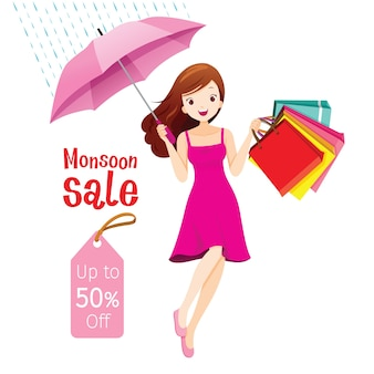 Venta de monzón, mujer bajo el paraguas saltando con muchas bolsas de la compra.