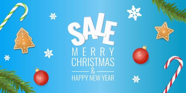 Venta de navidad banner de invierno con copos de nieve, ramas de abeto, galletas, bastón de caramelo duro y bolas rojas.