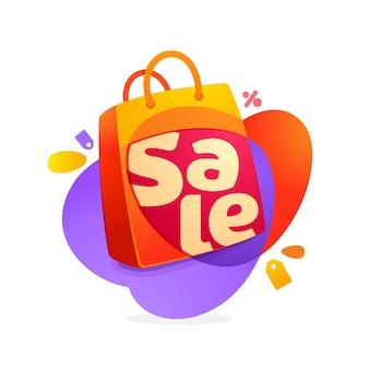 Venta palabra con icono de bolsa de compras y etiqueta de venta.