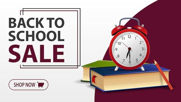 Venta de regreso a la escuela, pancarta blanca con libros escolares y reloj despertador