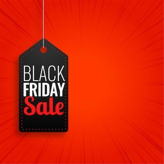 Venta de viernes negro etiqueta colgante sobre fondo rojo.