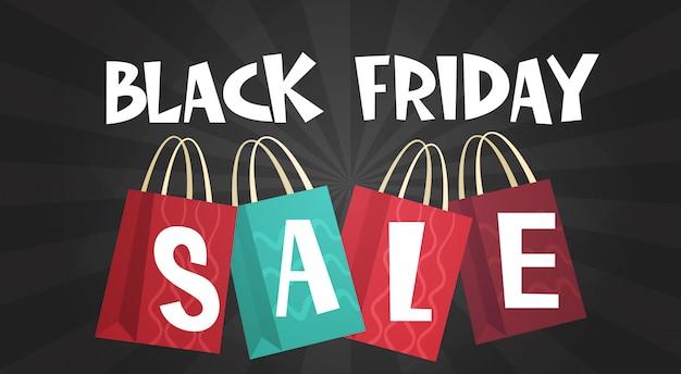 Venta de viernes negro sobre bolsas de compras
