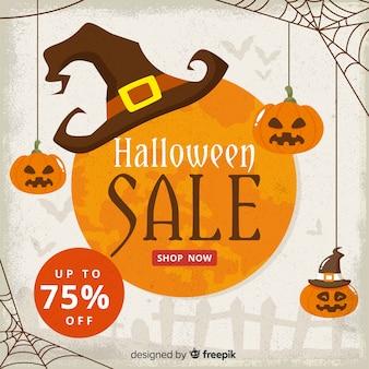 Venta vintage de halloween con tela de araña y calabazas