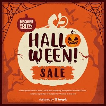 Venta vintage de halloween con telarañas y calabaza