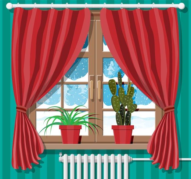 Ventana de invierno con cortinas rojas y vista desde la habitación
