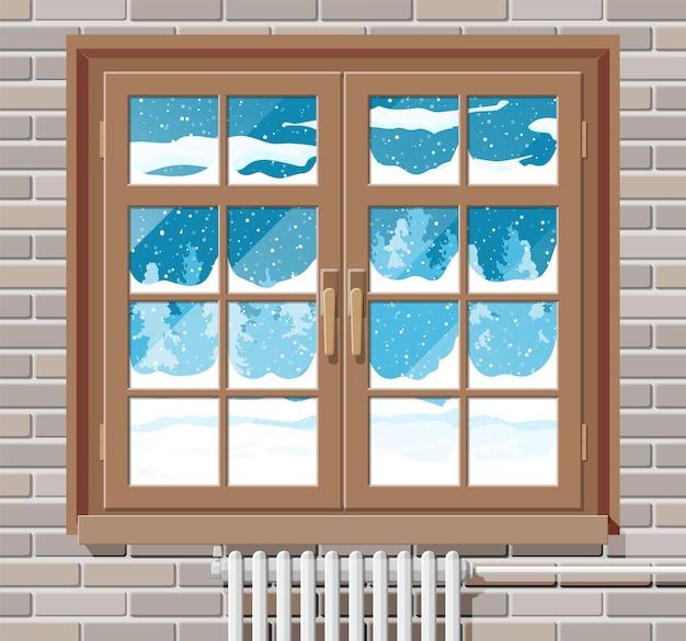 Ventana de invierno con pared de ladrillo y vista desde la habitación.