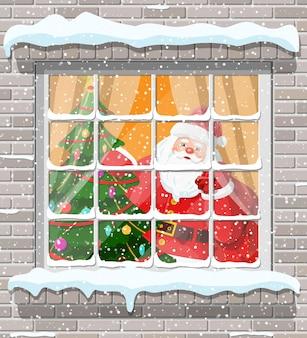 Ventana de navidad en pared de ladrillo