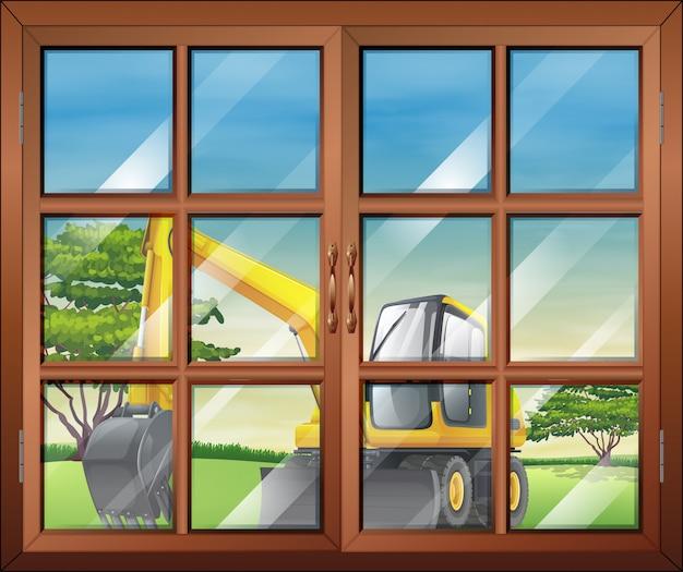 Una ventana con una vista de la excavadora afuera