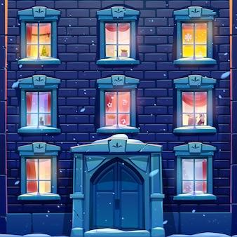 Ventanas nocturnas de casa o castillo con decoración de navidad y año nuevo